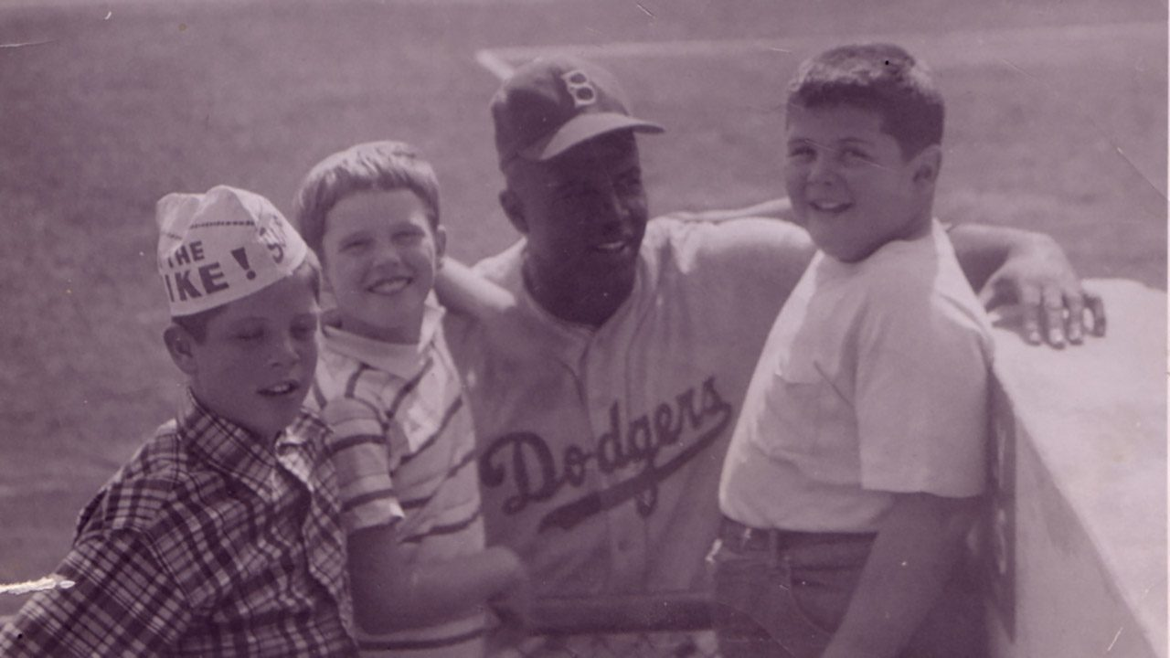With Jackie Robinson looking over their shoulder, Ron Rabinovitz (right) and his friend Smith Treuer and his sister Judy, at Milwaukee's County Stadium.